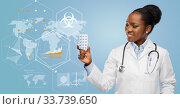 african american female doctor with medicine pills. Стоковое фото, фотограф Syda Productions / Фотобанк Лори