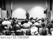 Купить «Business speaker giving a talk at business conference event.», фото № 33739654, снято 9 декабря 2019 г. (c) Matej Kastelic / Фотобанк Лори