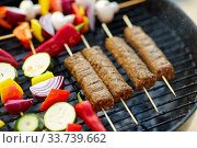 Купить «barbecue meat and vegetables roasting on grill», фото № 33739662, снято 19 сентября 2019 г. (c) Syda Productions / Фотобанк Лори