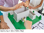 creative team building project layout at office. Стоковое фото, фотограф Syda Productions / Фотобанк Лори