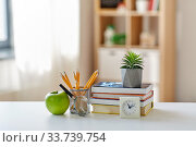 Купить «books, magnifier, pencils, apple on table at home», фото № 33739754, снято 5 сентября 2019 г. (c) Syda Productions / Фотобанк Лори
