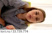 Купить «Cheerful millennial woman talking to camera video at home. Happy girl blogger social media influence recording lifestyle blog or shooting blog enjoying speaking to web cam. Web cam view», видеоролик № 33739774, снято 13 мая 2020 г. (c) Ekaterina Demidova / Фотобанк Лори