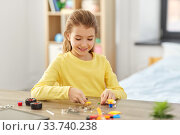 happy girl playing with robotics kit at home. Стоковое фото, фотограф Syda Productions / Фотобанк Лори