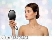 Купить «beautiful young woman looking to mirror», фото № 33740242, снято 30 ноября 2019 г. (c) Syda Productions / Фотобанк Лори