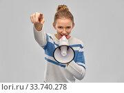 teenage girl speaking to megaphone. Стоковое фото, фотограф Syda Productions / Фотобанк Лори