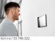 Купить «happy man looking at tablet computer at smart home», фото № 33740322, снято 21 марта 2020 г. (c) Syda Productions / Фотобанк Лори