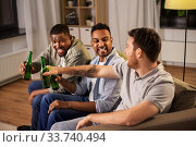 Купить «happy male friends drinking beer at home at night», фото № 33740494, снято 28 декабря 2019 г. (c) Syda Productions / Фотобанк Лори