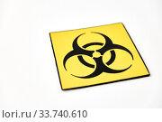 biohazard caution sign on white background. Стоковое фото, фотограф Syda Productions / Фотобанк Лори