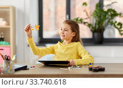 girl with tablet pc and robotics kit at home. Стоковое фото, фотограф Syda Productions / Фотобанк Лори