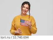 happy woman with flag of united states of america. Стоковое фото, фотограф Syda Productions / Фотобанк Лори