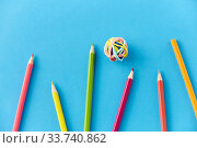 Купить «coloring pencils and rubber bands on blue», фото № 33740862, снято 10 сентября 2019 г. (c) Syda Productions / Фотобанк Лори