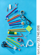 stationery or school supplies on blue background. Стоковое фото, фотограф Syda Productions / Фотобанк Лори