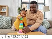 Купить «african family playing with baby daughter at home», фото № 33741162, снято 29 сентября 2019 г. (c) Syda Productions / Фотобанк Лори