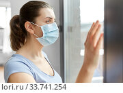 sick young woman wearing protective medical mask. Стоковое фото, фотограф Syda Productions / Фотобанк Лори