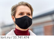 Купить «woman wearing protective reusable barrier mask», фото № 33741474, снято 9 апреля 2020 г. (c) Syda Productions / Фотобанк Лори