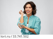 Купить «young woman in shirt suffering from pain in hand», фото № 33741502, снято 18 апреля 2020 г. (c) Syda Productions / Фотобанк Лори