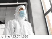 doctor in protective wear, mask and face shield. Стоковое фото, фотограф Syda Productions / Фотобанк Лори