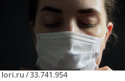 female doctor or nurse wearing medical face mask. Стоковое видео, видеограф Syda Productions / Фотобанк Лори