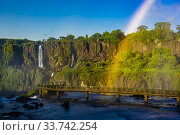 Купить «Rainbow, Iguazu Falls (Iguacu in Portugese), on the border of Brazil and Argentina. It is one of the New 7 Wonders of Nature and is a UNESCO World Heritage...», фото № 33742254, снято 28 февраля 2020 г. (c) age Fotostock / Фотобанк Лори