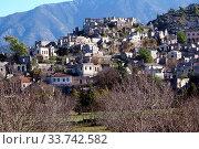 Купить «Orchard and ruins of houses in village Kayakoy near Fethie, Turkey», фото № 33742582, снято 28 мая 2020 г. (c) age Fotostock / Фотобанк Лори