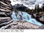 Купить «Athabasca Waterfall Alberta Canada river flow and blurred water», фото № 33746762, снято 11 июля 2020 г. (c) age Fotostock / Фотобанк Лори