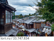 The tiled roofs of shopping Matsubara-dori street near Kiyomizu-dera temple. Kyoto. Japan. Редакционное фото, фотограф Serg Zastavkin / Фотобанк Лори