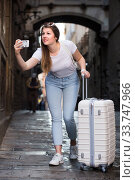 Купить «Adult woman is taking photo on her phone», фото № 33747966, снято 17 мая 2017 г. (c) Яков Филимонов / Фотобанк Лори
