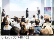 Купить «Male business speaker giving a talk at business conference event.», фото № 33748462, снято 15 июня 2018 г. (c) Matej Kastelic / Фотобанк Лори