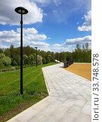 Купить «Beautiful boulevard with lanterns and benches in Zelenograd in Moscow, Russia», фото № 33748578, снято 13 мая 2020 г. (c) Володина Ольга / Фотобанк Лори