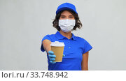 saleswoman in face mask with takeaway coffee cup. Стоковое видео, видеограф Syda Productions / Фотобанк Лори