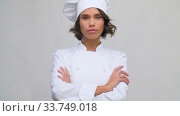 smiling female chef in toque. Стоковое видео, видеограф Syda Productions / Фотобанк Лори