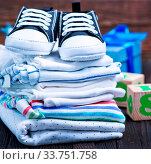 Купить «Baby clothes and shoes on the wooden table», фото № 33751758, снято 8 июля 2020 г. (c) age Fotostock / Фотобанк Лори