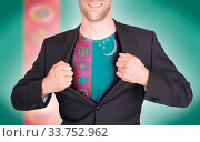 Купить «Businessman opening suit to reveal shirt with flag, Turkmenistan», фото № 33752962, снято 13 июля 2020 г. (c) age Fotostock / Фотобанк Лори