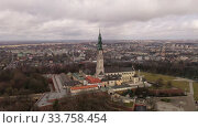 Купить «Aerial view of active Catholic Jasna Gora Monastery in Czestochowa on background with modern cityscape in spring, Poland», видеоролик № 33758454, снято 13 марта 2020 г. (c) Яков Филимонов / Фотобанк Лори
