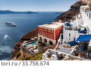 Купить «View of the greek city of Fira on the volcanic island of Santorini in the Aegean sea from the Cyclades archipelago in the Aegean sea», фото № 33758674, снято 7 июня 2017 г. (c) Наталья Волкова / Фотобанк Лори