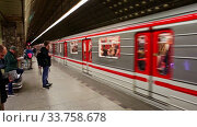 Купить «Interior of modern platform hall of Mustek station in Prague metro», видеоролик № 33758678, снято 13 октября 2019 г. (c) Яков Филимонов / Фотобанк Лори