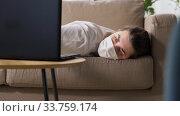 Купить «sick bored woman with laptop lying on sofa at home», видеоролик № 33759174, снято 3 мая 2020 г. (c) Syda Productions / Фотобанк Лори