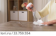 close up of woman cleaning table at home. Стоковое видео, видеограф Syda Productions / Фотобанк Лори