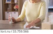 Купить «close up of woman cleaning table at home», видеоролик № 33759566, снято 10 мая 2020 г. (c) Syda Productions / Фотобанк Лори