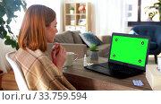 Купить «sick woman having video call on laptop at home», видеоролик № 33759594, снято 25 мая 2020 г. (c) Syda Productions / Фотобанк Лори