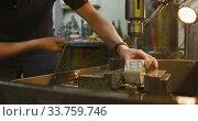 Купить «Caucasian male hands factory worker at a factory standing at a workbench and operating a machinery», видеоролик № 33759746, снято 23 ноября 2019 г. (c) Wavebreak Media / Фотобанк Лори
