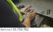 Купить «Close up detail of hands of a Caucasian male factory worker standing at a workbench and working on a», видеоролик № 33759782, снято 23 ноября 2019 г. (c) Wavebreak Media / Фотобанк Лори