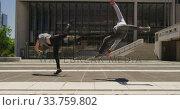 Купить «Caucasian men practicing parkour», видеоролик № 33759802, снято 31 октября 2019 г. (c) Wavebreak Media / Фотобанк Лори