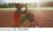 Купить «Disabled mixed race man with prosthetic legs sitting on racing track», видеоролик № 33759854, снято 17 марта 2020 г. (c) Wavebreak Media / Фотобанк Лори