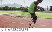 Купить «Disabled mixed race man with prosthetic legs running on race track and stopping», видеоролик № 33759878, снято 17 марта 2020 г. (c) Wavebreak Media / Фотобанк Лори