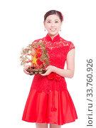 Купить «Young asian woman in red cheongsam holds gold ingot in chinese new year», фото № 33760926, снято 14 июля 2020 г. (c) age Fotostock / Фотобанк Лори