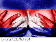 Купить «Sweaty upper part of female body, hands covering breasts, flag of Cambodia», фото № 33763754, снято 5 июня 2020 г. (c) age Fotostock / Фотобанк Лори