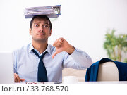 Купить «Young male employee working from house», фото № 33768570, снято 30 октября 2019 г. (c) Elnur / Фотобанк Лори