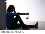 Купить «Young man suffering from alcoholism», фото № 33769370, снято 10 сентября 2019 г. (c) Elnur / Фотобанк Лори