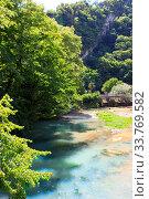 Купить «Mountain transparent river on a sunny summer day», фото № 33769582, снято 19 июня 2019 г. (c) Евгений Ткачёв / Фотобанк Лори